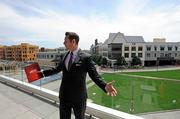 Andy DiOrio, the director of corporate communications, shows off AMC's patios, covered by a roof meant to replicate the exterior of a movie screen. Two upper decks connect via a state-of-the-art kitchen and meeting place. The patios also have fire pits and contemporary furniture.