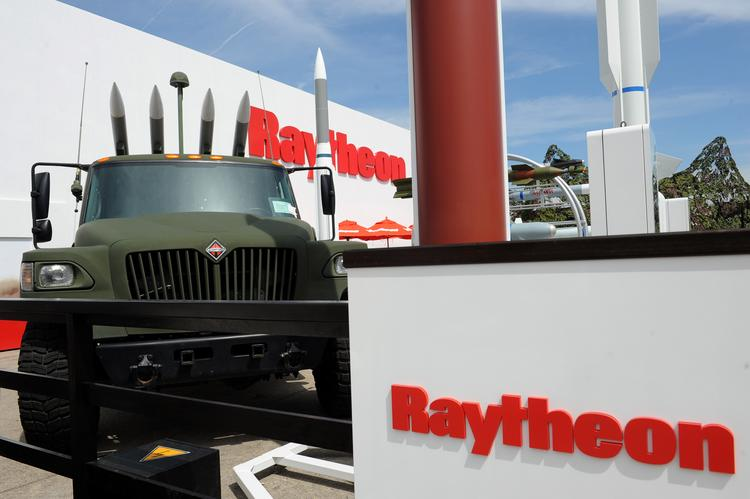 A missile launcher, a SL-AMRAAM vehicle sits on display at the Raytheon stand at the Paris Air Show in 2009.