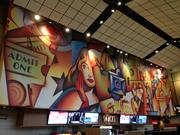 A large mural in the Cinemark theater lobby.