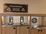 Cinemark divided up areas for trash and recycling. They found many customers do the same thing at home.