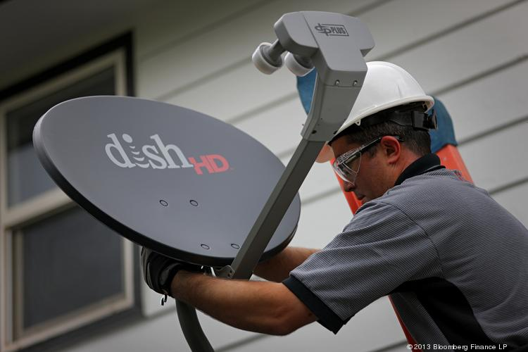 Justin Preziosi, field service specialist for Dish Network Corp., installs a satellite television system at a residence in Denver on Aug. 6. Dish Network recently lost an arbitrator's ruling over its application to control the .direct suffix for Internet addresses after DirecTV, its main rival, objected.