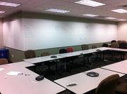 The former Zilliant space featured an uninspired conference room and makeshift conference table.