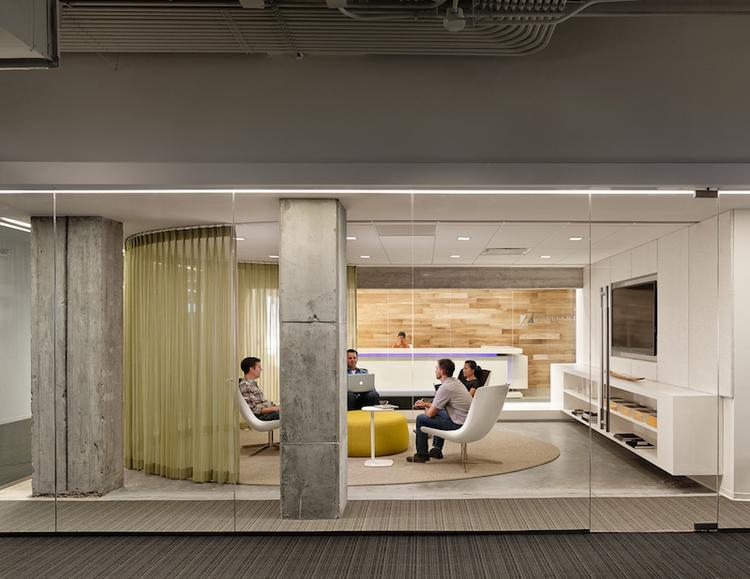 One of the showstoppers in Zilliant's new Austin space is a glass cube room, which connects the reception area and lobby to the workspaces.