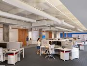 The open floor plan still provides for privacy. The work stations are configured so that no one looks straight into another work station.