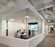 Another meeting space is big on white and glass.