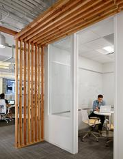 The space features numerous huddle rooms including this one with decorative wood accents.