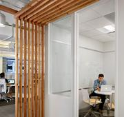 The new Zilliant space features numerous huddle rooms including this one with decorative wood accents.