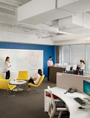 More informal huddle spaces mix with workstations, including a stand-up workstation for those who prefer it.