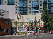 Visitors cross Southwest Broadway in front of Living Room Theater in Portland's West End.