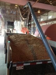 The used grain from the brewing process which is loaded onto a truck and delivered for free to local farmers. Maxwell said the farmers some times return the favor with free meat and eggs.