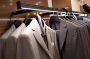 Here, Ermenegildo Zegna suits are elegantly displayed on a rack with its own underlighting.