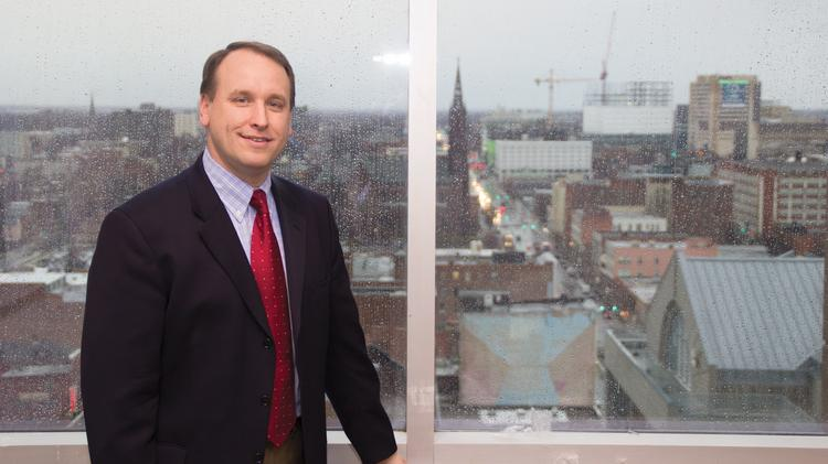 Pictured left, Kevin Cross, managing partner of Lippes Mathias Wexler Friedman, says his law firm's new office space at the Key Center at Fountain Plaza not only helps with collaboration among colleagues, but also features an ideal view of the Buffalo cityscape. The firm moved over the weekend and will be settling into its new space throughout this week.