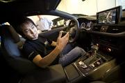 Volkswagen engineer Karric Kwong demos a prototype of an infotainment system equipped with new voice control technology. Ultimately, the system should be able to process real time conversations and display relevant online information.