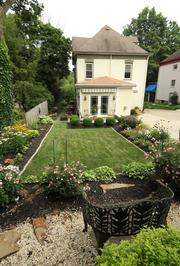 Kate Dewey's Rosslyn Farms Victorian home had an addition put on the back of it in 2012. She added a garden also.