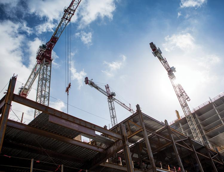 Three tower cranes have been working around the clock at the site of the JW Marriott hotel in Downtown Austin.