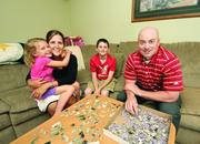 C.J. and Angela Gray, with their children, Samantha, 6, and Brenden, 11, in their South Park home.