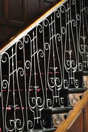 The iron railing on the main staircase.