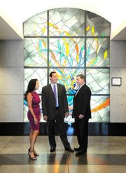 Attorney Jeff Koewler, center, meets with Eric Johannessen and Lisa Fields of VSP, one of his longtime clients.