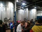 Guests mingled in the production facility.