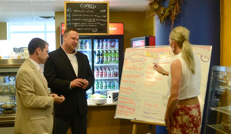 (From left) Benovate President Jeff Houdek, Founder Mike Reier and Director of Health and Wellness Pam Baker check out Benovate's healthy options at C. McGee's Deli in downtown Minneapolis.