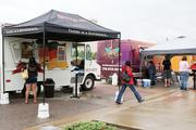"""Let'm Eat Brats and The Flying Stove were among food trucks parked at WaterWalk on July 28 for the """"Food Truck Rally."""" Such cooperative events are common for local food trucks."""