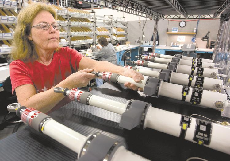 Triad Boeing suppliers such at Triumph Actuation Systems are lobbying contacts at the company to locate its 777X jet production locally. In this file photo, Shirley Wheeler handles parts in the final stages before shipment at Triumph.