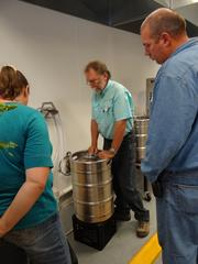 Keith Elliot, chair of Rockingham Community College's Department of Brewing, Distillation & Fermentation, explains the kegging process during a grand opening of the Center for Brewing Sciences Thursday.