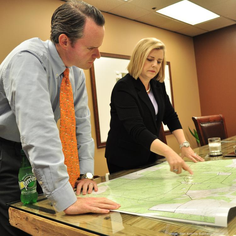 "J. Byron ""Trace"" Burton III and Shelly Jewett, partners with San Antonio law firm Uhl, Fitzsimons, Jewett & Burton PLLC, look over the map of an oil lease. Representing Eagle Ford landowners is a large share of the firm's business."