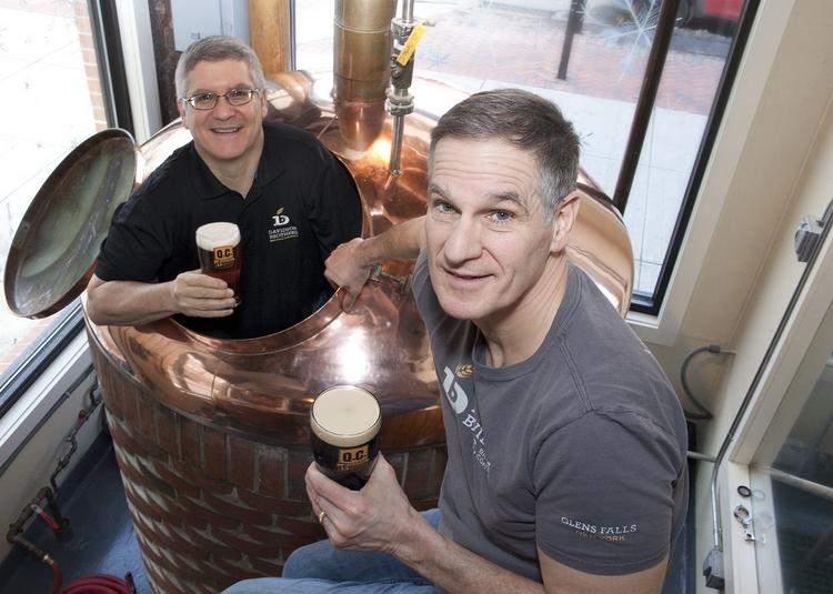 Rick Davidson (in the kettle) and John Davidson, owners of Davidson Brothers Brewing Co.