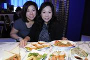 Annie, left, and Alice Yeung, check out a variety of dishes at the new Panya Bistro in the Hokua.