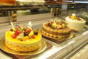 From left, mango mousse cake in a 8-inch round, tiramisu with lady fingers and strawberry shortcake in one of the glass encasements in the new Panya Bistroin the Hokua.