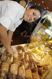 Carmen Montejo, bakery chef for Panya Bistro, organizes freshly baked cookies and pastries.