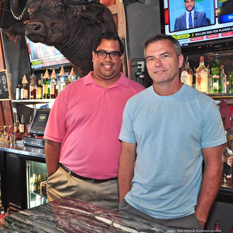 (L to R) Joel Rivas and Lee Beekly — with Nelson the Cape buffalo in the background — are bringing a taste of Americana to the Broadway corridor with the opening of Leon.
