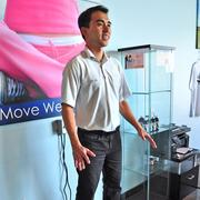Dr. Khoa Ho demonstrates Pinnacle's new vibration plate, designed to tone and define muscles.