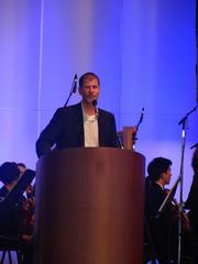 Todd Mitchell, one of Cynthia and George Mitchell's children, speaking at Thursday night's tribute