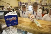 Workers keep the products coming for guests to the Wisconsin State Fair.