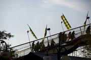 Fairgoers ascend the stairs to ride the giant slide.