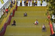 The giant slide is always a popular attraction at the fair.