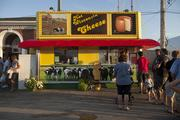 Food booths seem to beckon around every corner at the 2013 Wisconsin State Fair.