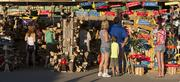 Fairgoers enjoyed a sunny slice of summer as they checked out the merchandise available at the 2013 Wisconsin State Fair.