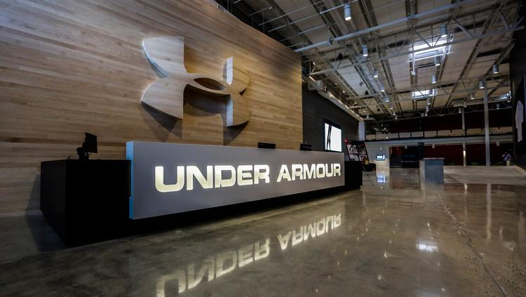 65945dc9aba The welcome desk at Under Armour s new Building 37 office in Port Covington.