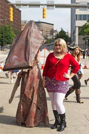 Renee Archbold (left) and Isobel Barry dressed as characters from Silent Hill — Pyramid Head and Maria, respectively — for Otakon 2013 at the Baltimore Convention Center.