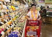 Lakewood resident, Carolyn Grant celebrated Dallas' first Trader Joe's by dressing up the occassion with a hat.