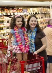 The Hawaiian lei's were a hit with 4-year-old Elliana Mitchell and her mother, Keri.