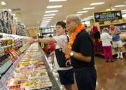 Shoppers Phil and Rose Murose check out the prices that earned Trader Joe's the nick name Two Buck Chuck.