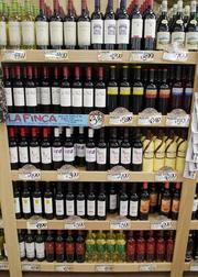 Wine at several price points line the wall in the Lower Greenville Trader Joe's.