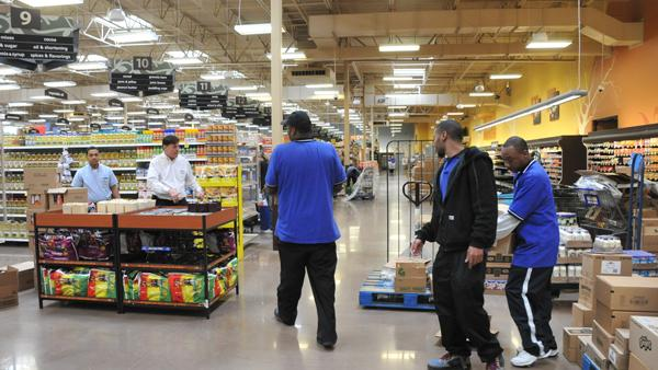 Kroger employees stock shelves in anticipation of the new store opening in Memphis.