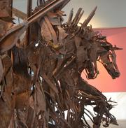"""Eduardo H. Xochitiotzin' """"Los Ochos Cabillos"""" was made about 1970. Scrap metal was used to sculpt the figures of eight horses."""