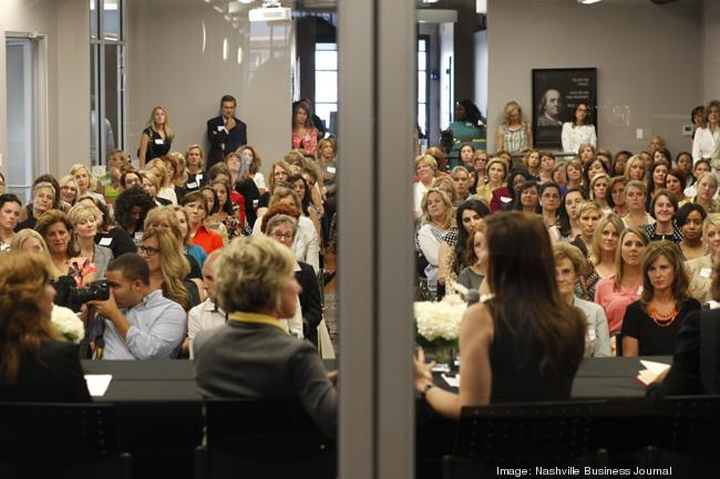 Guests listen to speakers during the launch of Evolve Women at the Nashville Entrepreneur Center at Rolling Mill Hill.