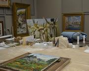 A back room in the museum is where work is done on paintings that need some restoration.